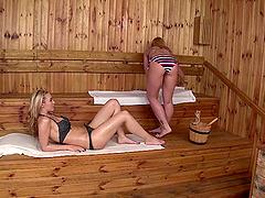 Lesbian adventure in the hot sauna..