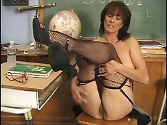 Hot mature chick rubs her beautiful..