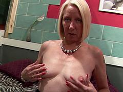 Blonde granny enjoys fingering her wet..