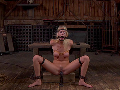 Blonde with a ring gag face fucked by..