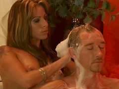 Hot woman washes her lover's hair in..