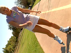 Sports blonde in miniskirt getting..