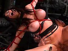 Bondage doll with big tits getting..