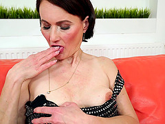 Mature brunette Alice Sharp plays with..