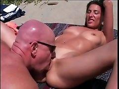 Bikini girl sucks a fat dick on a..