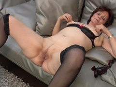 Sassy mature granny moans while..