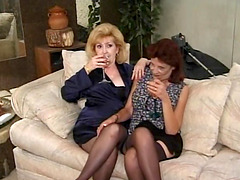 Two mature sluts have their clits..
