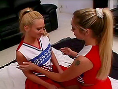 Blonde cheerleader in uniform having..