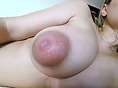 Hot sexy girl toying her big tits on..