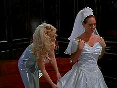 Lady in a wedding dress spreads her..