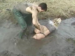 Randy woman fucked in mud by a pussy..