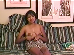 Horny lady Nadia Nice plays with a..