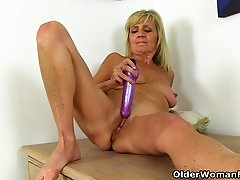 English gilf Dolly puts her dildo to..
