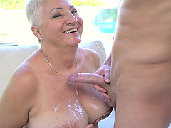 Big breasted mature blonde Astrid..