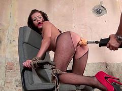 Adel is a slave in red heels bent over..