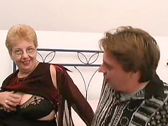 Grabbing Ann's mature saggy tits and..