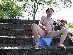Horny mature woman caught masturbating..