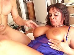 Big breasted mature brunette spreads..