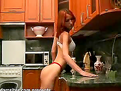 Red haired skinny babe Dafna looks..