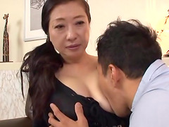 Mature Japanese woman spreads her legs..