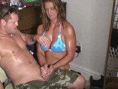 Busty bikini girl giving a great handjob