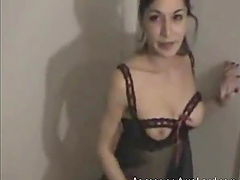 This video contains horny brunette masturbating in the corner