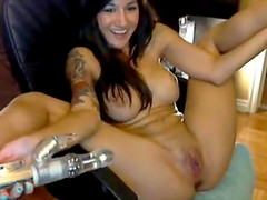 Alluring busty girl pushing dildo in..