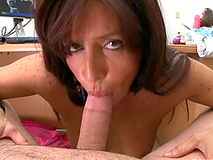 Mature brunette lady is sucking young..
