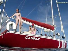 Redhead skinny dipping off a boat