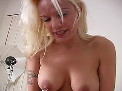 Blonde MILF is giving a passionate handjob