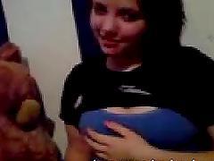 Cute emo girl is teasing her nipples..