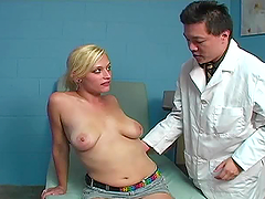 Doctor cures his blonde patient with..