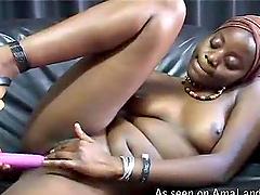 African babe  masturbates with dildo..