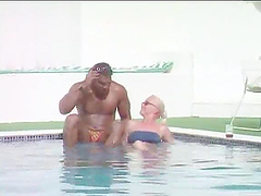 Interracial swimming pool story with a naughty blondy