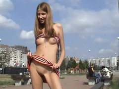 Hot skinny teen shows her small tits and pussy in public