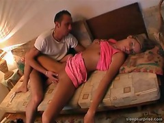 He gets a blowjob from a sleeping girl