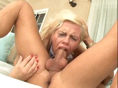 He pushes blonde whore down on his cock