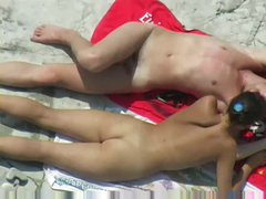 Couple messing around at the beach