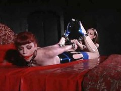 Lesbian latex fetish domination with..
