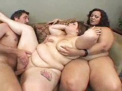 One man playing with two BBW sluts