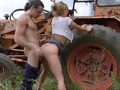 Busty babe gets fucked on a tractor