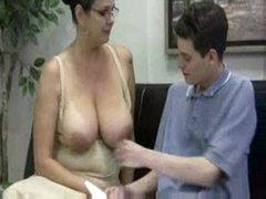His mature tutor gives him a handjob