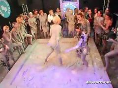 Well dressed girls mud wrestling