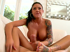 Footjob From Tattooed Babe