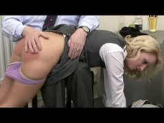 Over the knee spanking reddens her ass
