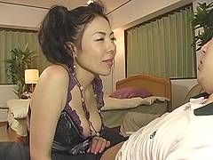 Really Horny Asian MILF Enjoying a Cock