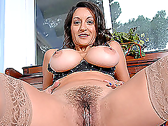 Busty brunette milf gets naked and..