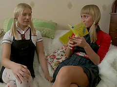 Pigtailed teen lesbians are having a..